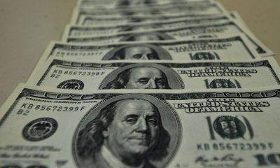 Dólar bate recorde histórico e chega a R$ 5,71